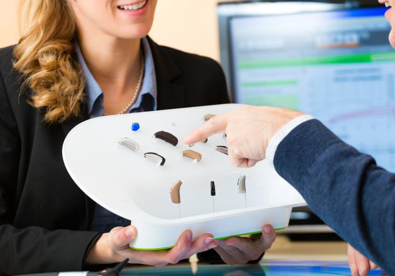 Audiologist demonstrating Phonak hearing aid brand portfolio