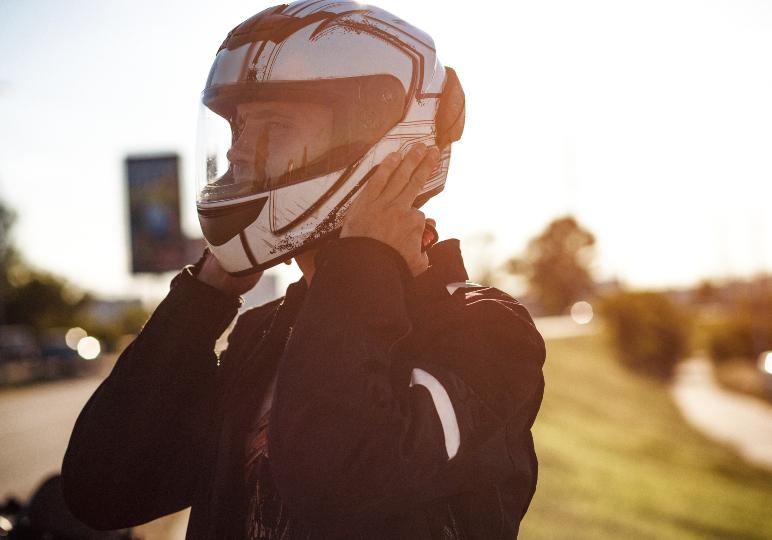 Motorcyclist wearing custom hearing protection under helmet